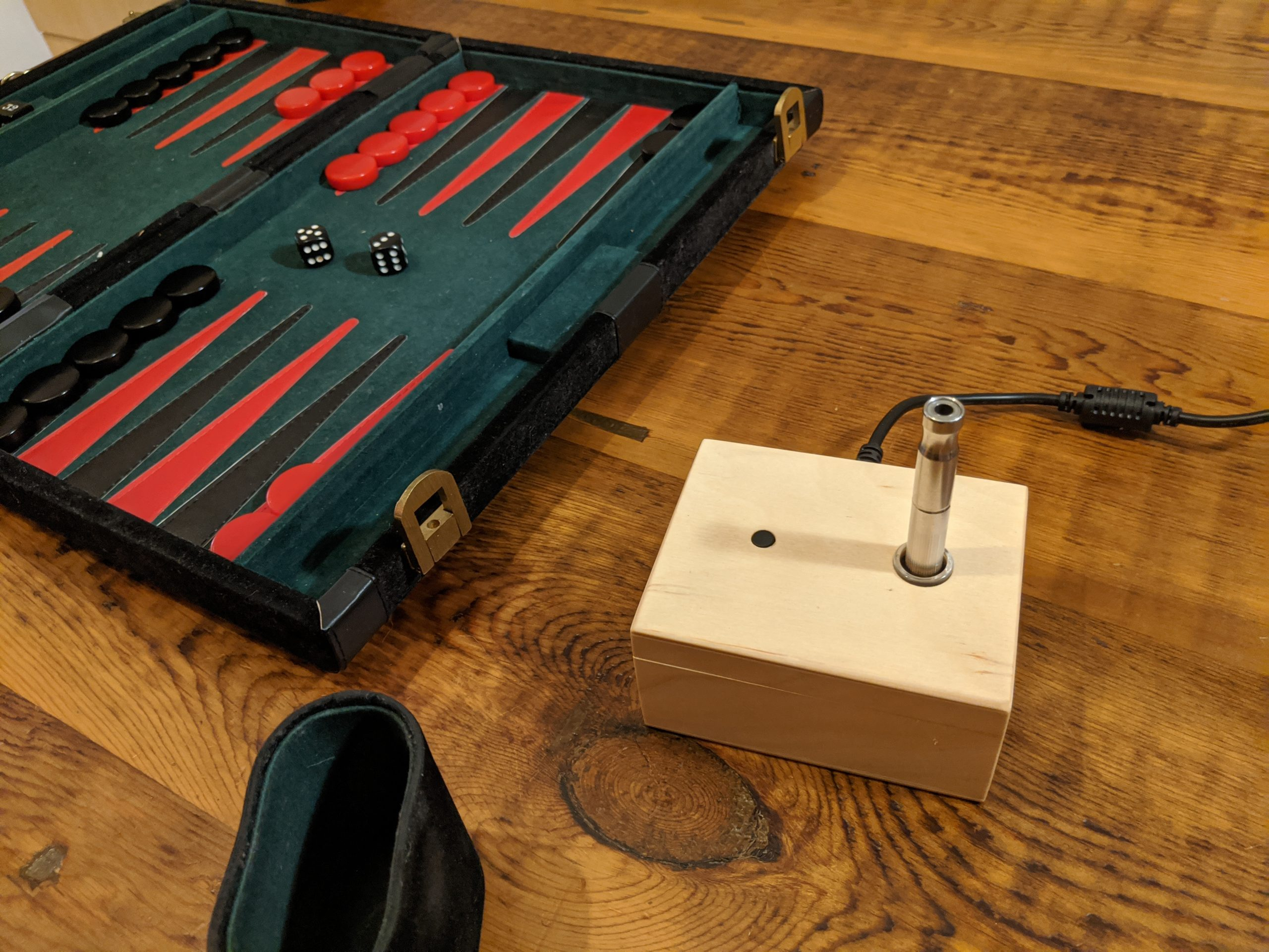 A VapOven Classic DynaVap induction heater being enjoyed along with a game of backgammon